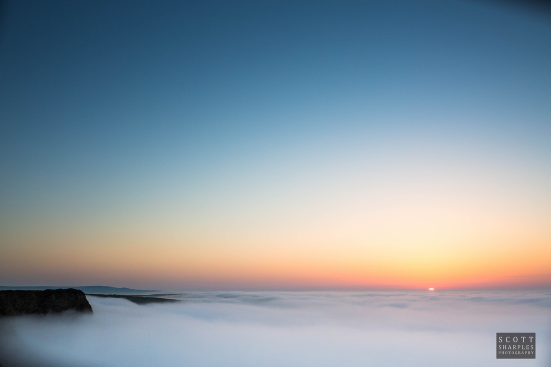 sea fog gathering at sunset near Gwithian on the north cliffs, Cornwall