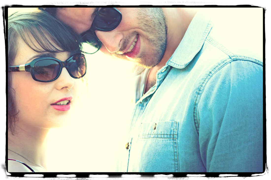 A portrait that Will and Sophie were delighted with.  Couple head shot with sunglasses.