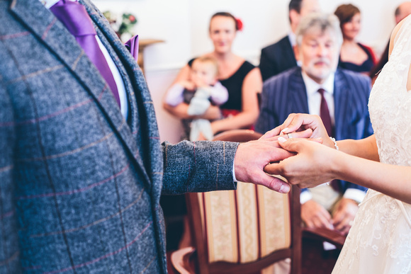 Bride and groom exchanging vows and rings