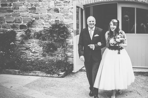 wedding photographer Cornwall - Alex and her father about to enter the ceremony a the rustic wedding venue that is Nancarrow Farm