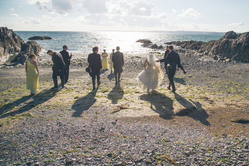 Wedding pics on the beach below Polhawn Fort by Scott Sharples Photography
