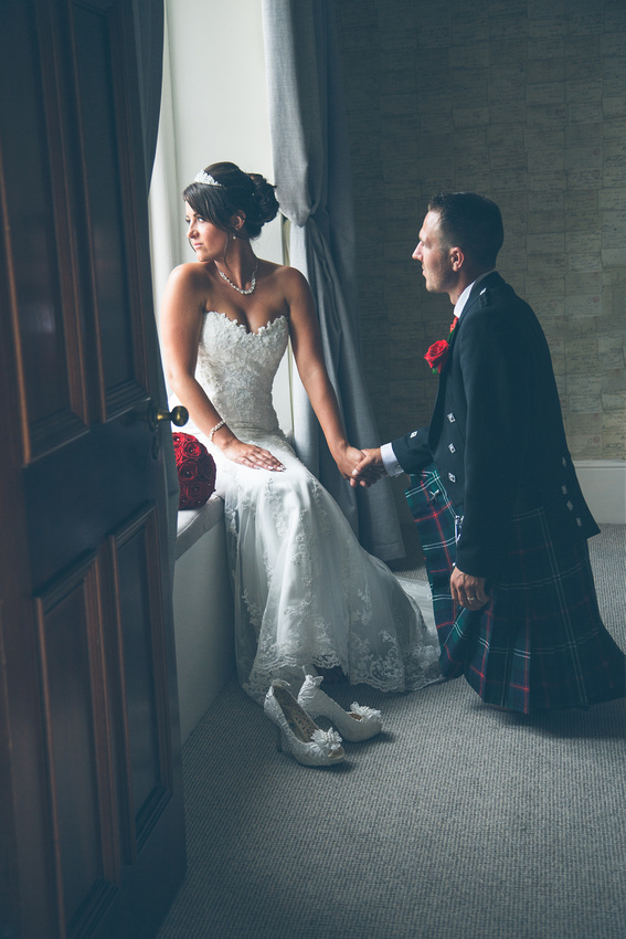 Newlyweds in the soft natural light of the window