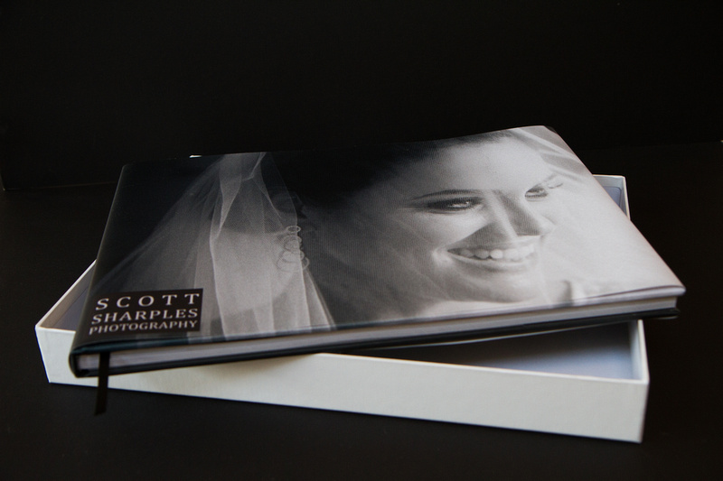 A one off bespoke designed wedding album that is hand finished with printed cover and dust jacket and supplied in a protective presentation box