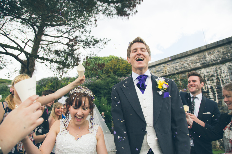 Wedding confetti being thrown at Polhawn Fort