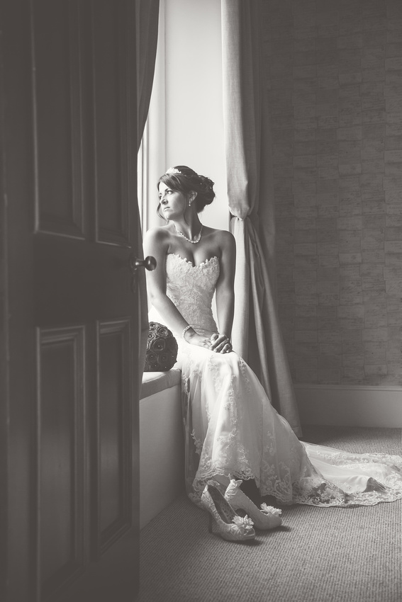 Nataliee in her wedding gown in the natural light of the window