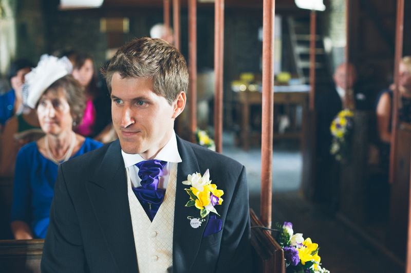 A nervous but proud groom waits for his bride at Rame Church, Cornwall