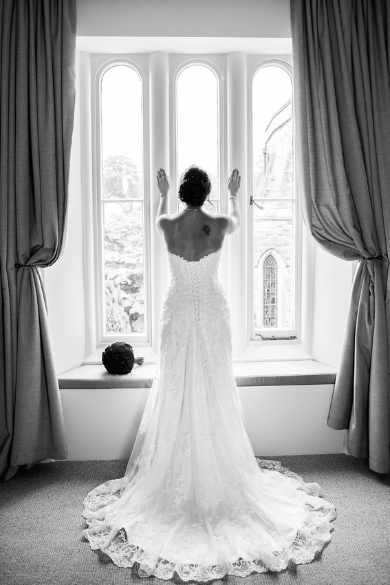 A black and white portrait of Nataliee in her stunning bridal gown