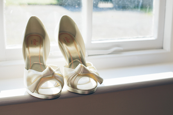 Cate's elegant shoes were a perfect match for her lovely vintage wedding dress
