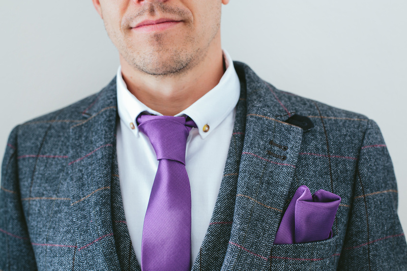 Groom's jacket and matching waistcoat complimenting the colour of his tie and 'kerchief