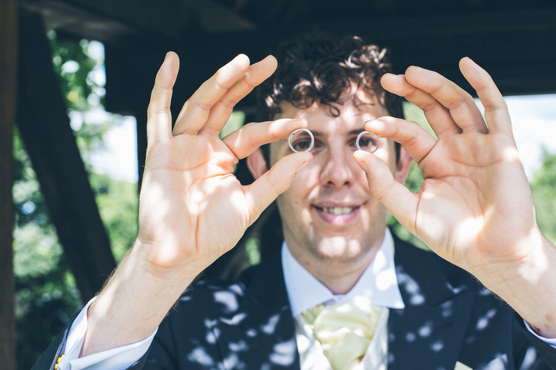 Best man showing the wedding rings by Scott Sharples Photography