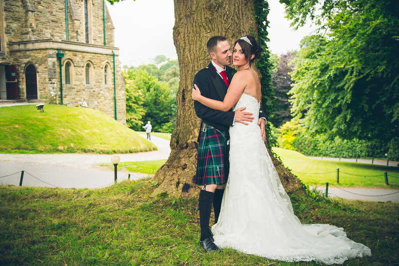 Bridal couple portrait in the grounds of the Alverton Manor, outside the Great Hall