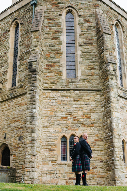Pre-ceremony image of the groom and his best man in front of the imposing facade that is the Great Hall at the Alverton Manor Hotel