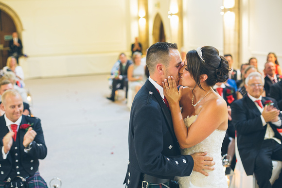 Husband and wife having a first kiss