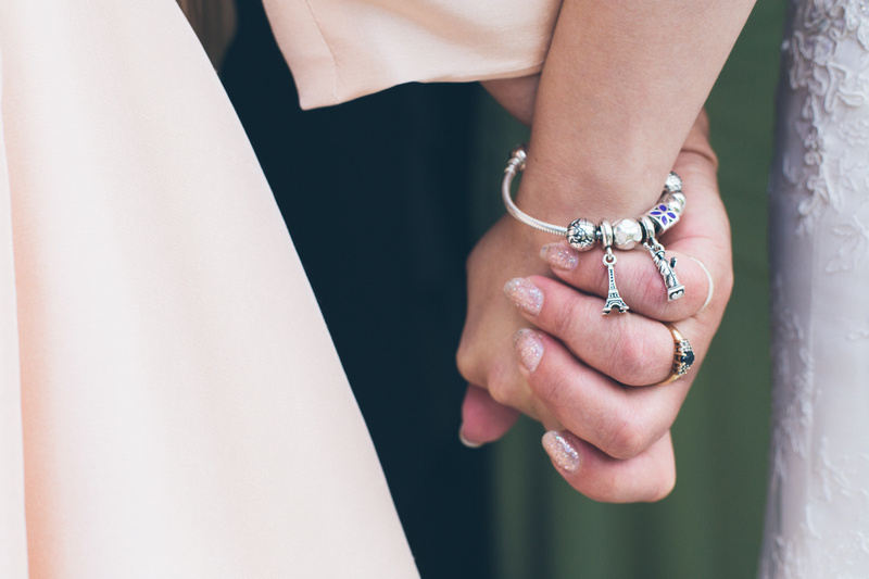 Mum and daughter holding hands before the wedding ceremony