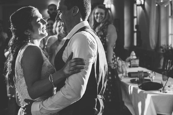 Newlyweds Neil and Cate enjoying their first dance together as husband and wife